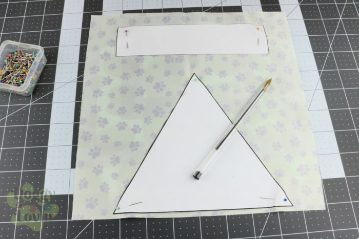 Pin pattern to fabric and trace around