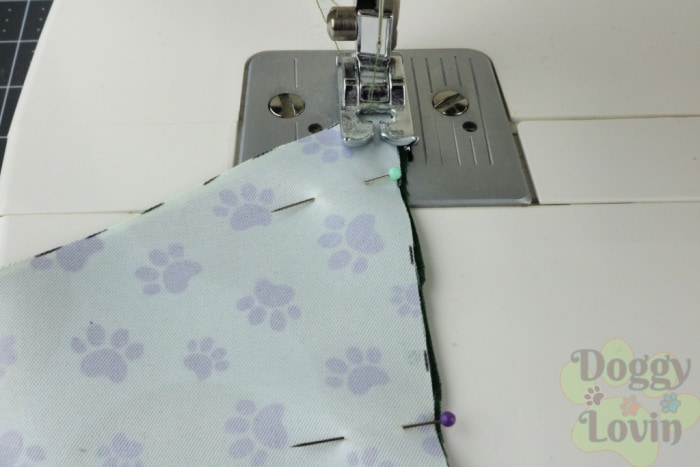 Sew fabrics together on pinned sides
