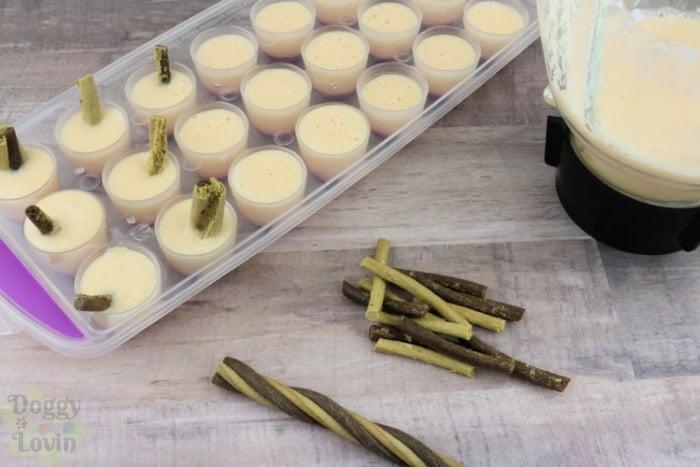 Add treat stix to molds