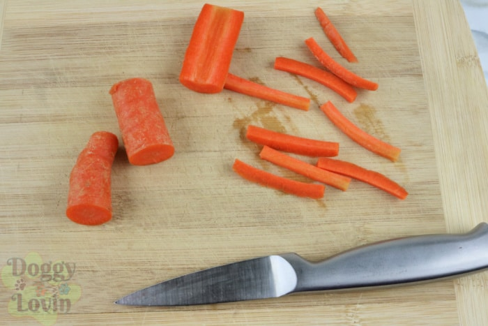 Carrot being cut into fry size pieces