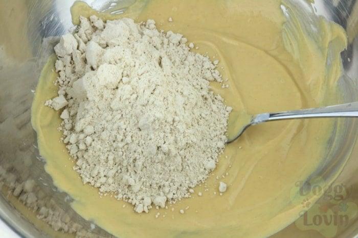 Flour dumped into batter mixture