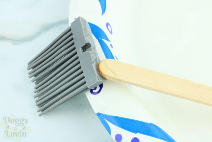 craft stick adding epoxy to back of brush