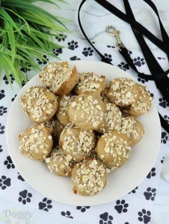 White plate full of mini banana dog muffins